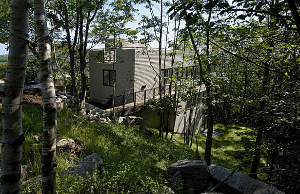 A home on Bridgeview Drive in Halifax fitted into the side of a steep hill reveals an architecture of comfort, not luxury. (Susan Fitzgerald Architect, Photo: James Steeves)