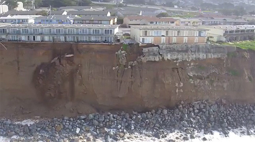 Drone footage shows the severity of coastal erosion at this Pacifica, CA cliff following heavy El Niño rains. (Image via huffingtonpost.com)