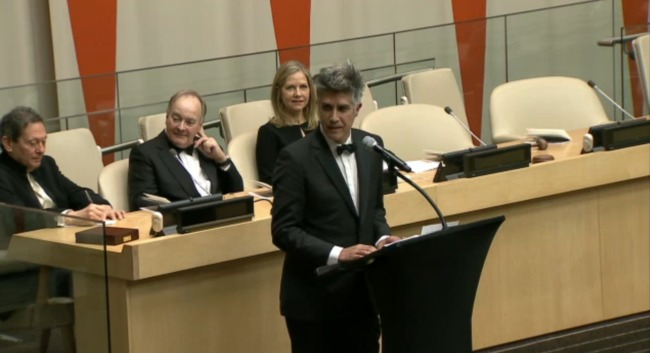 Alejandro Aravena accepts the Pritzker Prize during a ceremony at the United Nations in New York City.