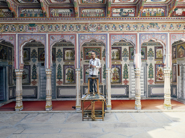 Built in 1902 and now a museum, Podar Haveli in Nawalgarh is one of the best-restored havelis in the region. Here, a painter does some touch-up work. Credit Nick Ballon