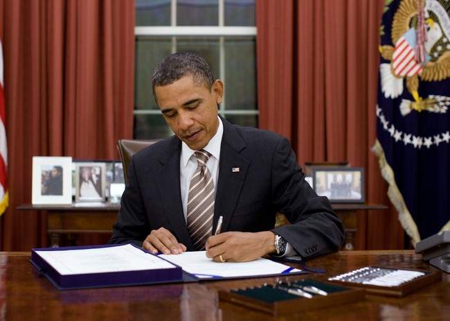 President Obama signing a bill, via wikimedia.org
