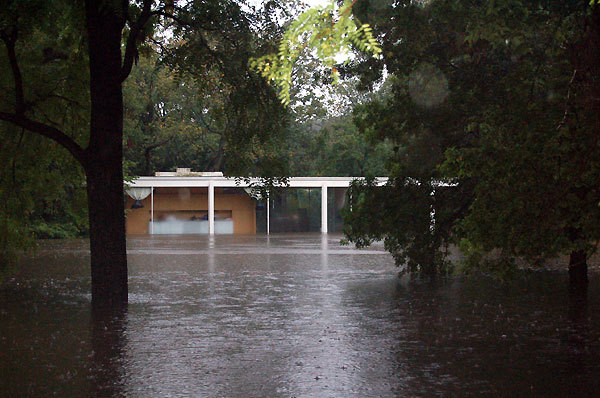 Floodwaters at the Farnsworth House in 2008. Image from National Trust for Historic Preservation, via chicagotribune.com.