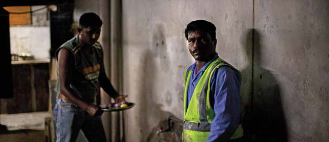 """Photo: Benjamin Crowe; via the ITUC's 2015 report """"Qatar: Profit and Loss. Counting the cost of modern day slavery in Qatar: What price freedom?"""""""