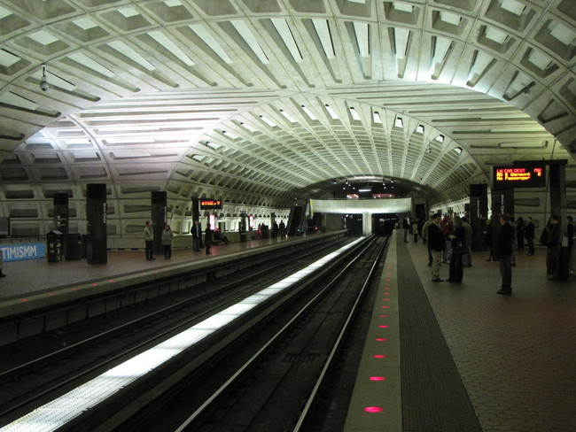 The coffered concrete ceilings of Metro Center in DC. Image via wikimedia.