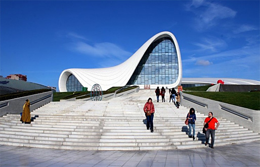 "The Heydar Aliyev Center in Azerbaijan's capital of Baku has earned worldwide recognition for its Zaha Hadid design — as well as outrage about reported human rights violations. Calvert Journal writer Anya Filippova calls it ""the most celebrated piece of modern architecture in the post-Soviet world."" (Photo: ljubar; Image via calvertjournal.com)"
