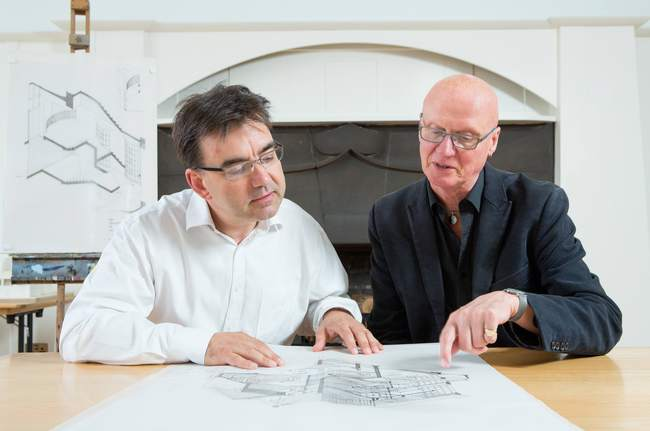 Professor Tom Inns (left) and Professor George Cairns (right) look at some of the special drawings donated to the GSA. Photo: Alan McAteer.
