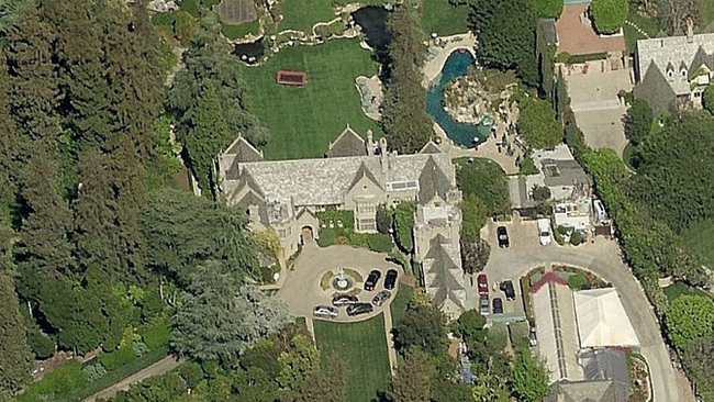 About to take home that $1.3B lottery jackpot this week? Here's a nice LA starter home. It's got a swimming pool with a grotto that could tell stories. (Aerial photo: Bing; Image via variety.com)