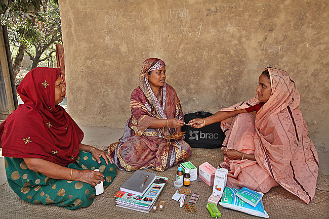 Shasthya Shebika (Health Volunteer) Kit: BRAC. Bangladesh, 1977-present. Medicine, sanitary napkins, delivery kit, soap, salt, registrar to maintain records, pictorial dosage instructions. Photo: © BRAC