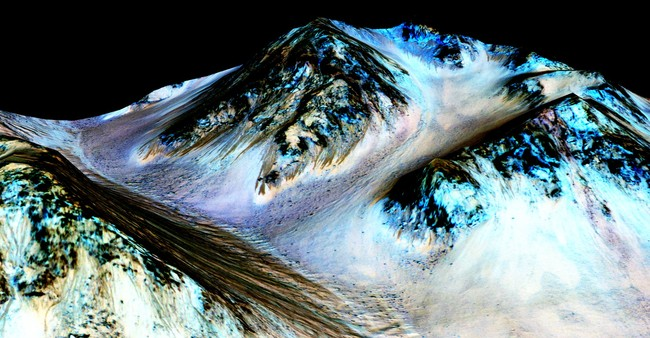 """These dark, narrow, 100 meter-long streaks called recurring slope lineae flowing downhill on Mars are inferred to have been formed by contemporary flowing water. Recently, planetary scientists detected hydrated salts on these slopes at Hale crater, corroborating their original hypothesis that the streaks are indeed formed by liquid water."" Credits: NASA/JPL/University of Arizona"