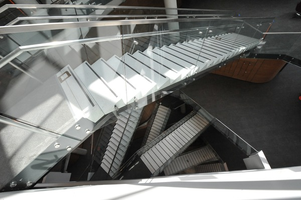 Stairs inside GW's Milken Institute School of Public Health are a central feature of the building, meant to attract visitors to walk up the steps and get more activity. Elevators have a less central location. (Washington Business Journal; Photo: Joanne Lawton)