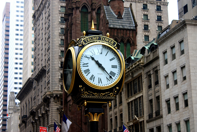 "The Electric Time Company clock in front of Trump Tower on Fifth Avenue. According to The New York Times, ""Neither the Trump Organization nor the city could confirm whether the $300 annual fee for clock's setting had been paid."" Image by Michel Riallant via flickr."