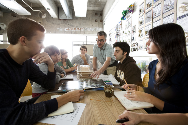 Associate Dean Brook Muller works with UO architecture students on a studio design project that aligns urban redevelopment and improved ecological function.
