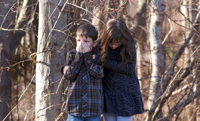 Young children wait outside Sandy Hook Elementary School after a shooting in Newtown, Connecticut, December 14, 2012. A shooter opened fire at the elementary school in Newtown, Connecticut, on Friday, killing dozens including children, the Hartford Courant newspaper reported. REUTERS/Michelle...