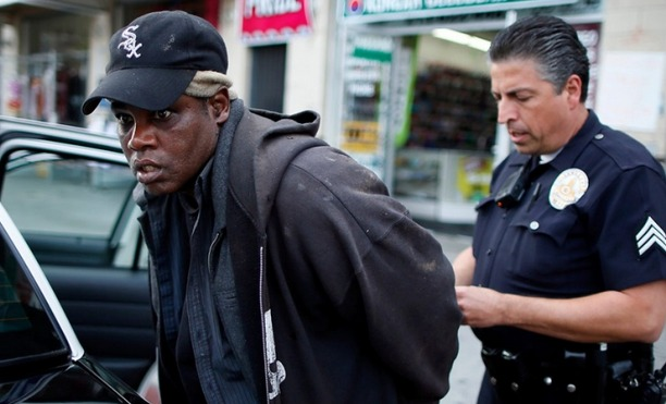 Homeless man arrested in NYC. Credit: Lucy Nicholson / REUTERS / LANDOV
