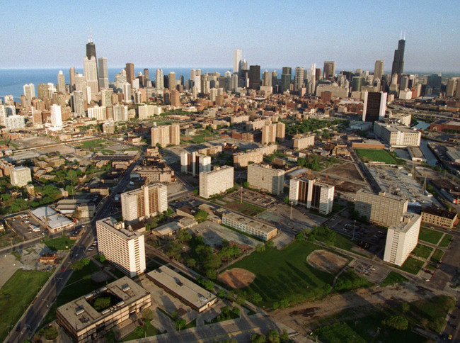 Cabrini-Green public housing project, foreground and mid-photo high-rises, is seen against the Chicago Skyline in May 1996. (AP Photo/Beth A. Keiser)
