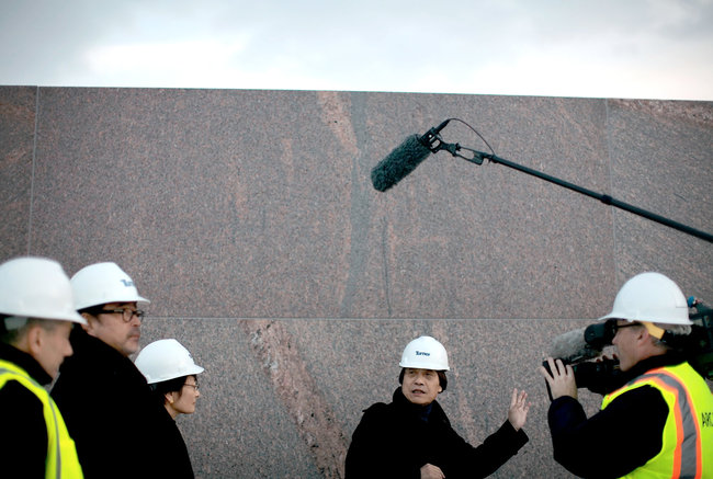 The architect Tadao Ando, center, visiting the Clark. Credit Nathaniel Brooks for The New York Times.