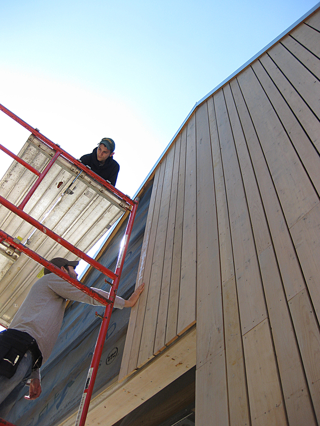 Students completing siding