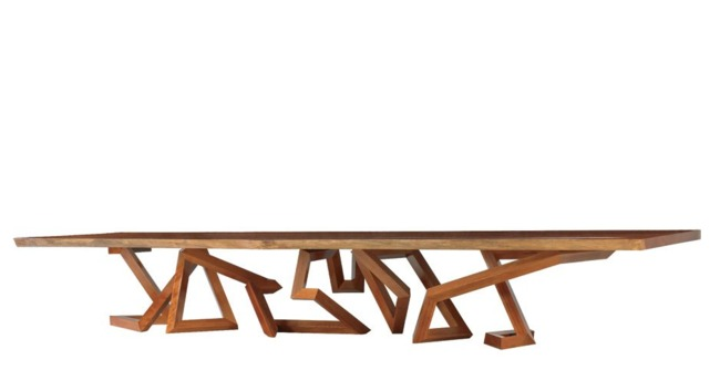 A 17-foot-long dining table (shown in redwood) is supported by a complex base formed from a twisting single line—a common theme in Pitt's designs Photo- Ellen McDermott