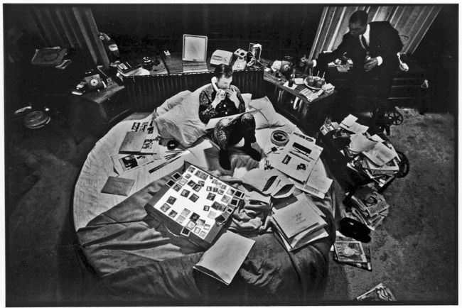 Hugh Hefner at the helm of his media empire: the bed. Image via averyreview.com.