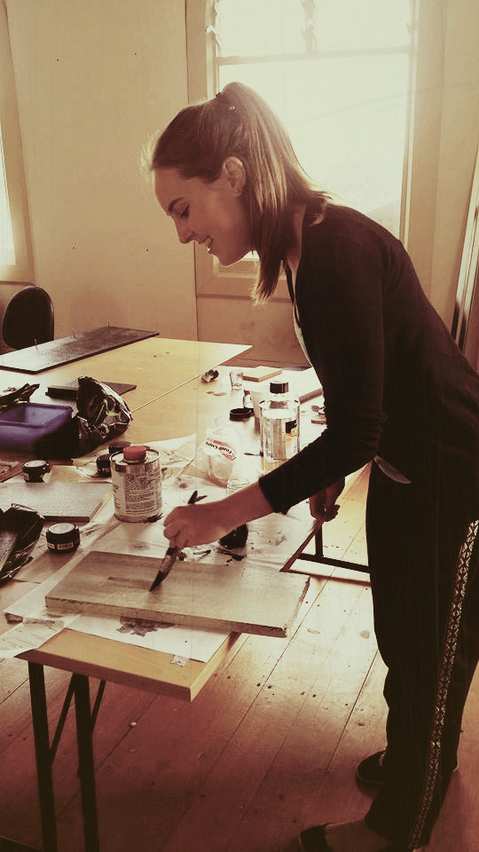 Hannah Smith painting a wall panel for the client presentation Mood Board