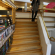 The Regional Library of Lapland. Jennifer Wong on sunken reading room stairs.