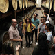 Participants on a tour of a rum facility. Image via