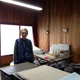 Yanai San standing in his home office